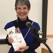 Sharon Leder holding her book, The Fix