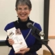 Sharon Leder holding her book, The Fix